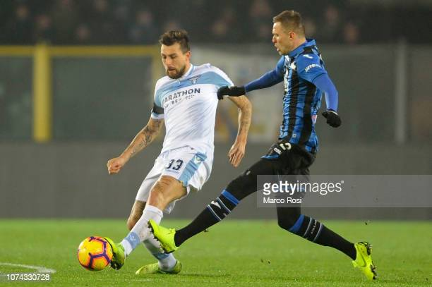 Josip Ilicic of Atalanta BC compete for the ball with Fracesco Acerbi of SS Lazio during the Serie A match between Atalanta BC and SS Lazio at Stadio...