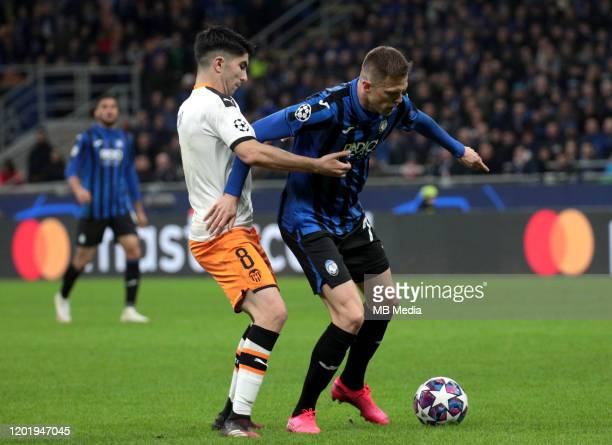 Josip Ilicic of Atalanta Bc competes for the ball with Carlos Soler of Valencia CF during the UEFA Champions League round of 16 first leg match...