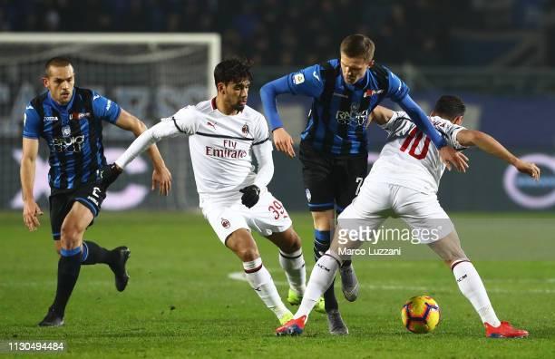 Josip Ilicic of Atalanta BC competes for the ball with Hakan Calhanoglu and Lucas Paqueta of AC Milan during the Serie A match between Atalanta BC...