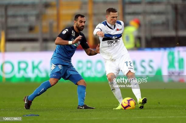 Josip Ilicic of Atalanta BC in action against Domenico Maietta of Empoli FC during the Serie A match between Empoli and Atalanta BC at Stadio Carlo...