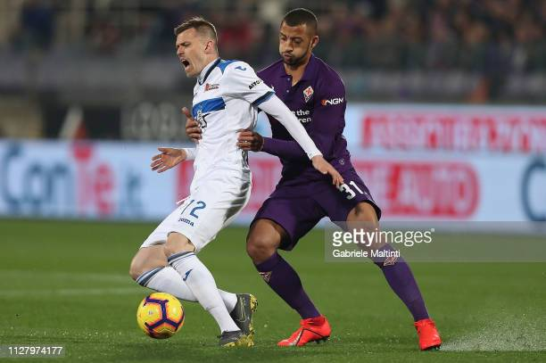 Josip Ilicic of Atalanta BC in action against Vitor Hugo of ACF Fiorentina during the Coppa Italia match between ACF Fiorentina and Atalanta BC on...