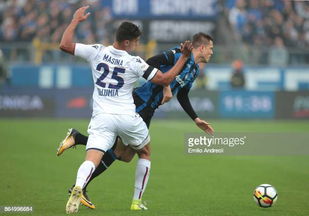 Josip Ilicic of Atalanta BC is challenged by Adam Masina of Bologna FC during the Serie A match between Atalanta BC and Bologna FC at Stadio Atleti...