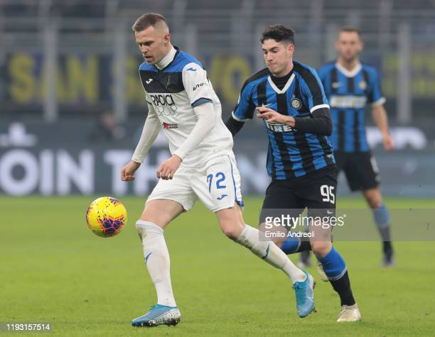 Josip Ilicic of Atalanta BC is challenged by Alessandro Bastoni of FC Internazionale during the Serie A match between FC Internazionale and Atalanta...