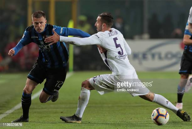 Josip Ilicic of Atalanta BC is challenged by Federico Ceccherini of ACF Fiorentina during the TIM Cup match between Atalanta BC and ACF Fiorentina at...