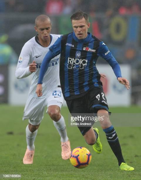 Josip Ilicic of Atalanta BC is challenged by Joao Miranda de Souza Filho of FC Internazionale during the Serie A match between Atalanta BC and FC...