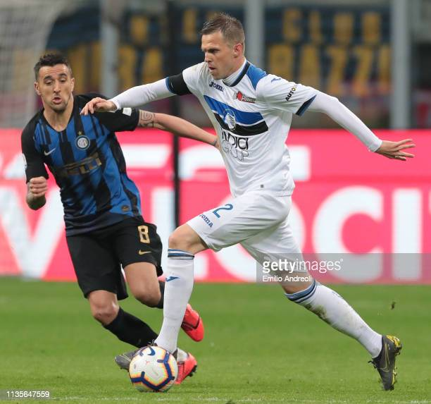 Josip Ilicic of Atalanta BC is challenged by Matias Vecino of FC Internazionale during the Serie A match between FC Internazionale and Atalanta BC at...