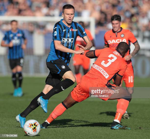 Josip Ilicic of Atalanta BC is challenged by Samir of Udinese Calcio during the Serie A match between Atalanta BC and Udinese Calcio at Gewiss...