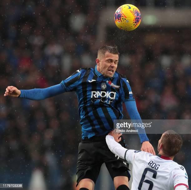 Josip Ilicic of Atalanta BC jumps for the ball against Marko Rog of Cagliari Calcio during the Serie A match between Atalanta BC and Cagliari Calcio...