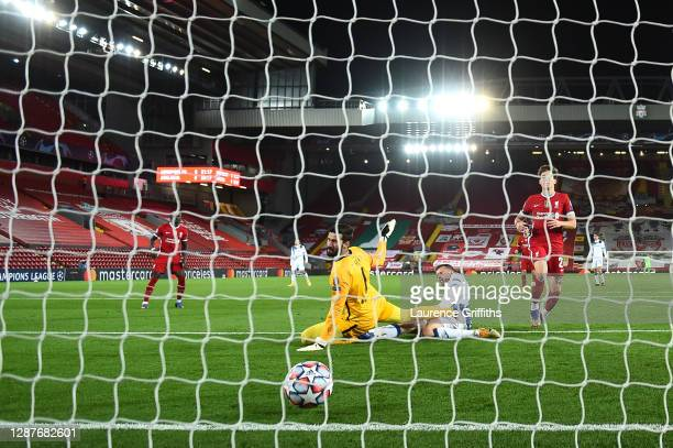 Josip Ilicic of Atalanta B.C. Scores their team's first goal past Alisson Becker of Liverpool during the UEFA Champions League Group D stage match...