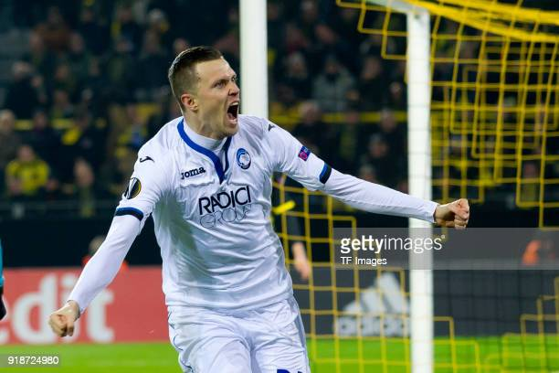 Josip Ilicic of Atalanta Bergamo celebrates after scoring his team`s first goal during UEFA Europa League Round of 32 match between Borussia Dortmund...