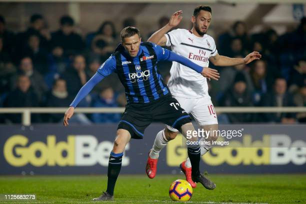 Josip Ilicic of Atalanta Bergamo Hakan Calhanoglu of AC Milan during the Italian Serie A match between Atalanta Bergamo v AC Milan at the Stadio...