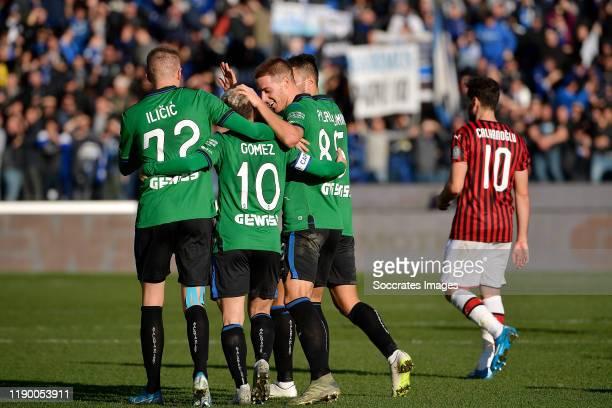 Josip Ilicic of Atalanta celebrates 40 with Timothy Castagne of Atalanta Rafael Toloi of Atalanta Marten de Roon of Atalanta during the Italian Serie...