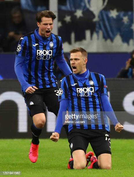Josip Ilicic of Atalanta celebrates his goal with his teammate Hans Hateboer during the UEFA Champions League round of 16 first leg match between...