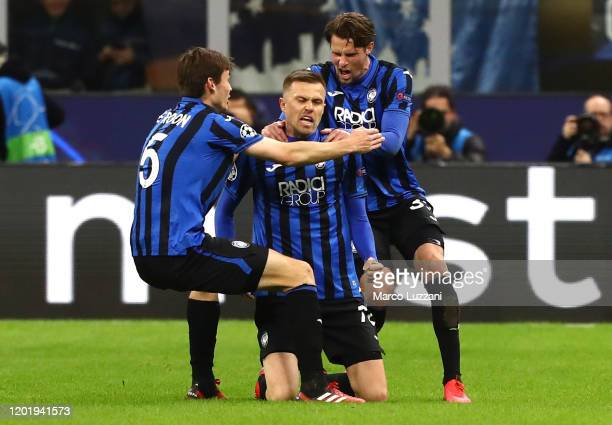 Josip Ilicic of Atalanta celebrates his goal with his teammates Hans Hateboer and Marten De Roon during the UEFA Champions League round of 16 first...
