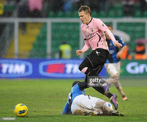 Josip Ilicic of Palermo and Luca Cigarini of Atalanta compete for the ball during the Serie A match between US Citta di Palermo and Atalanta BC at...