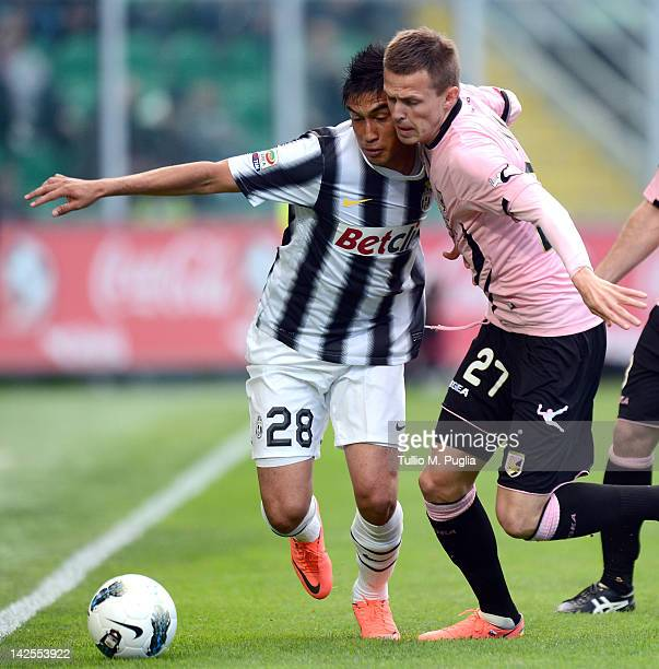 Josip Ilicic of Palermo and Marcelo Estigarribia of Juventus compete for the ball during the Serie A match between US Citta di Palermo and Juventus...