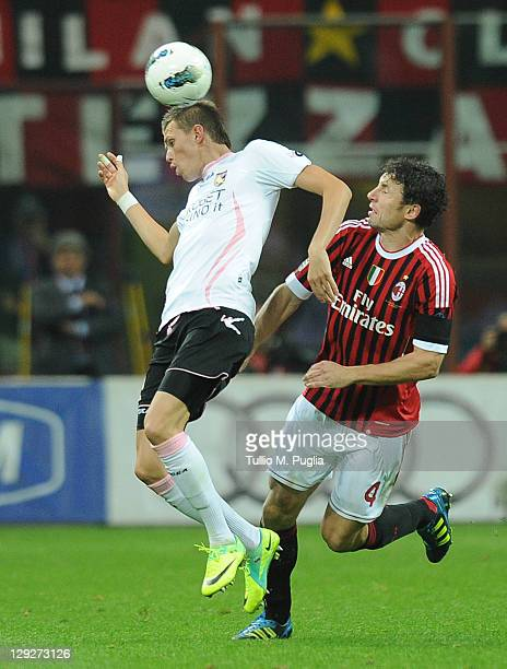 Josip Ilicic of Palermo and Mark Van Bommel of Milan compete for the ball during the Serie A match between AC Milan and US Citta di Palermo at Stadio...