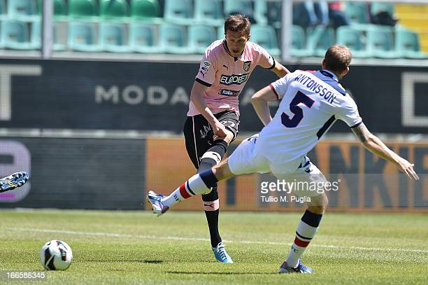 Josip Ilicic of Palermo and Mikael Antonsson of Bologna compete for the ball during the Serie A match between US Citta di Palermo and Bologna FC at...