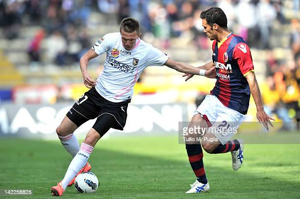 Josip Ilicic of Palermo and Nicolo Cherubin of Bologna compete for the ball during the Serie A match between Bologna FC and US Citta di Palermo at...