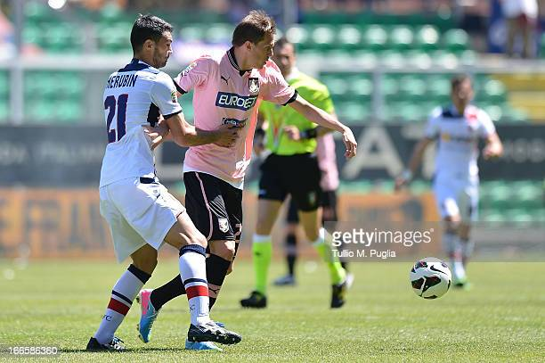 Josip Ilicic of Palermo and Nicolo Cherubin of Bologna compete for the ball during the Serie A match between US Citta di Palermo and Bologna FC at...