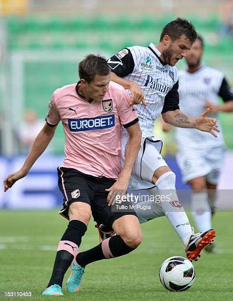 Josip Ilicic of Palermo and Perparim Hetemaj of Chievo compete for the ball during the Serie A match between US Citta di Palermo and AC Chievo Verona...