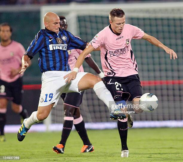 Josip Ilicic of Palermo battles for the ball with Estebn Cambiasso of Inter during the Serie A match between US Citta di Palermo and FC...