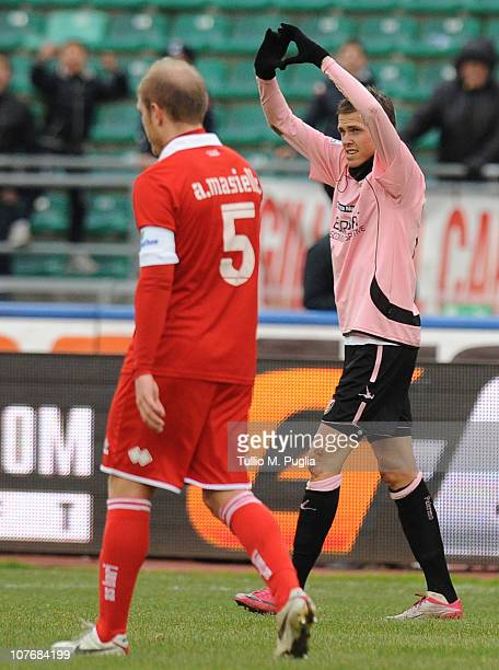 Josip Ilicic of Palermo celebrates the opening goal as Andrea Masiello of Bari looks dejected during the Serie A match between Bari and Palermo at...