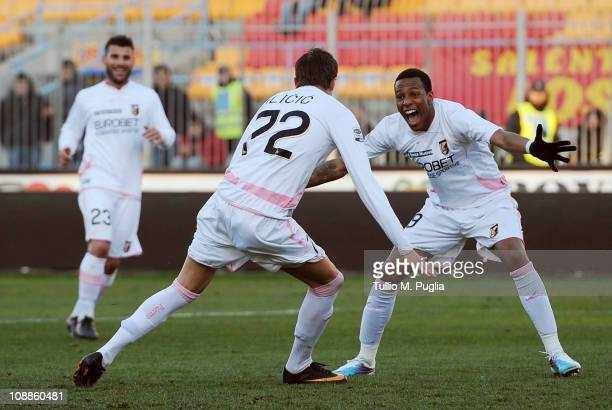 Josip Ilicic of Palermo celebrates with his mates Abel Hernandez and Antonio Nocerino after scoring his team's fourth goal during the Serie A match...