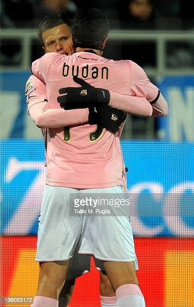 Josip Ilicic of Palermo celebrates with teammate Igor Budan after scoring the opening goal during the Serie A match between Novara Calcio and US...