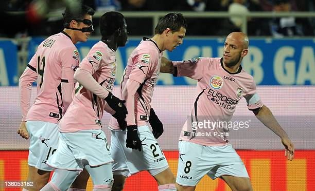 Josip Ilicic of Palermo celebrates with teammates after scoring the opening goal during the Serie A match between Novara Calcio and US Citta di...