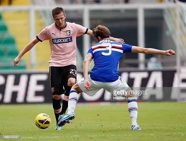 Josip Ilicic of Palermo competes for the ball with Andrea Costa of Sampdoria during the Serie A match between US Citta di Palermo and UC Sampdoria at...