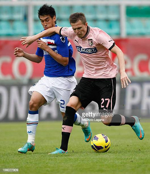 Josip Ilicic of Palermo competes for the ball with Marcelo Estigarribia of Sampdoria during the Serie A match between US Citta di Palermo and UC...