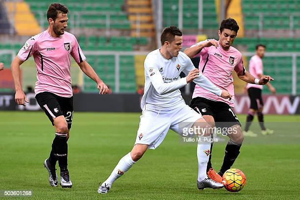 Josip Ilicic of Palermo is challenged by Franco Vazquez and Aleksandar Trajkovski of Palermoduring the Serie A match between US Citta di Palermo and...