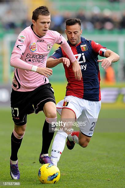 Josip Ilicic of Palermo is challenged by Giandomenico Mesto of Genoa during the Serie A match between US Citta di Palermo and Genoa CFC at Stadio...