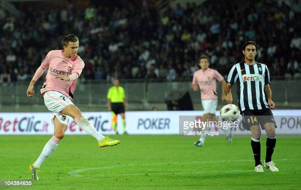 Josip Ilicic of Palermo scores a goal as Alberto Aquilani of Juventus looks on during the Serie A match between Juventus and Palermo at Olimpico...