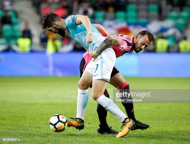 Josip Ilicic of Slovenia in action against Steven Fletcher of Scotland during the FIFA 2018 World Cup Qualifier match between Slovenia and Scotland...