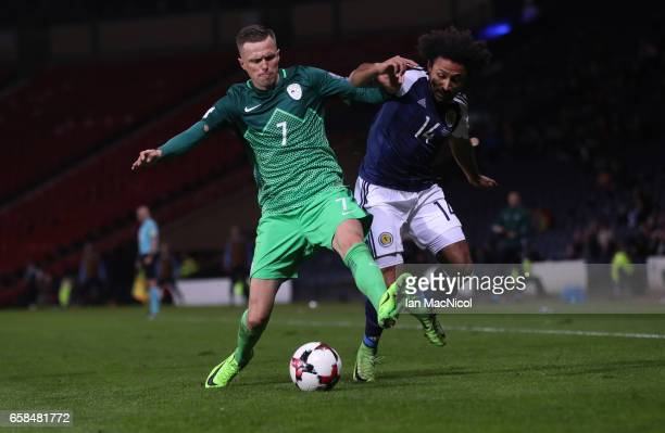 Josip Ilicic of Slovinia vies with Ikechi Anya of Scotland during the FIFA 2018 World Cup Qualifier between Scotland and Slovenia at Hampden Park on...