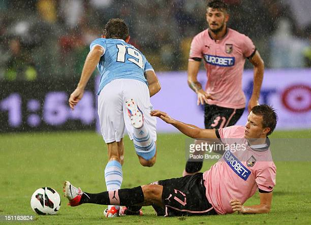 Josip Ilicic of US Citta' di Palermo competes for the ball with Senad Lulic of SS Lazio during the Serie A match between SS Lazio and US Citta di...
