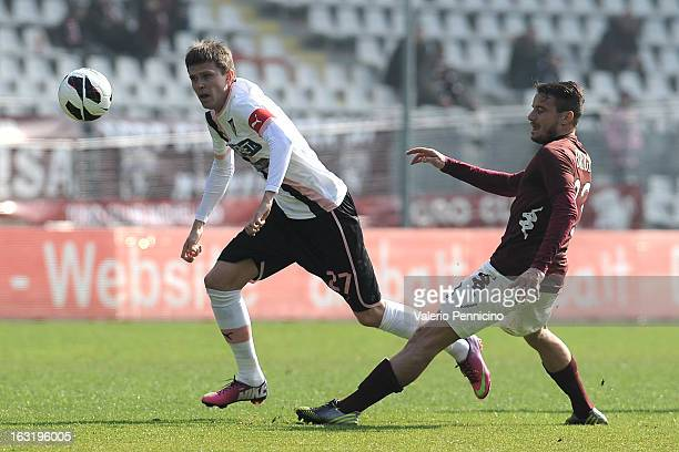 Josip Ilicic of US Citta di Palermo is tackled by Matteo Brighi of Torino FC during the Serie A match between Torino FC and US Citta di Palermo at...