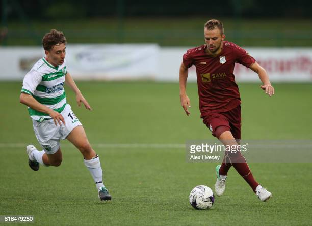Josip Misic of HNK Rijeka takes on Thomas Holland of The New Saints FC during the UEFA Champions League second qualifying round second leg match...