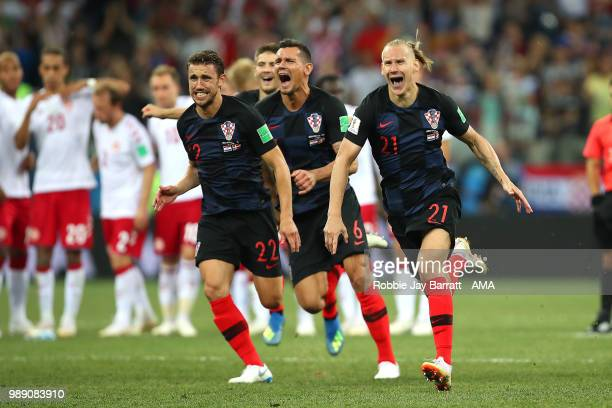 Josip Pivaric Domagoj Vida and Dejan Lovren of Croatia celebrate after winning a penalty shootout during the 2018 FIFA World Cup Russia Round of 16...