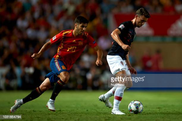 Josip Pivaric of Croatia controls the ball front Marco Asensio of Spain during the UEFA Nations League football match between Spain and Croatia at...