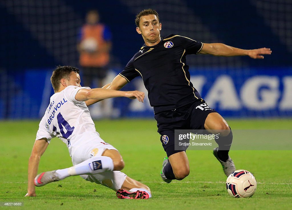 Josip Pivaric (R) of FC Dinamo Zagreb competes for the ball against Martin Linnes (L) of FC Molde during the UEFA Champions League Third Qualifying Round 1st Leg match between FC Dinamo Zagreb and FC Molde at Maksimir stadium on July 28, 2015 in Zagreb, Croatia.
