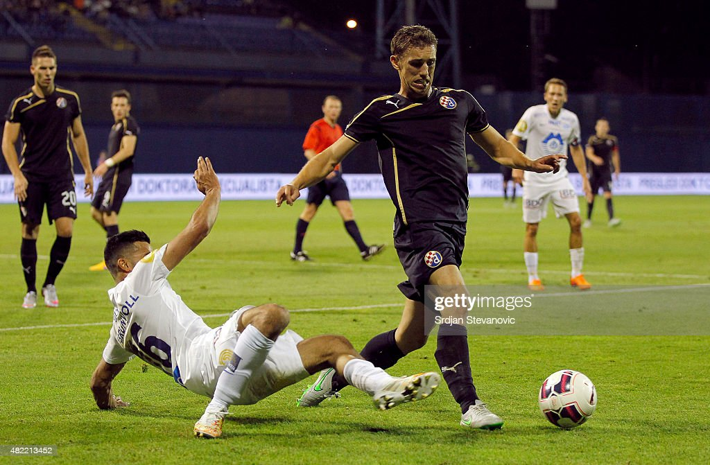 ZAGREB, CROATIA - JULY 28. Josip Pivaric (R) of FC Dinamo Zagreb is challenged by Etzaz Hussain (L) of FC Molde during the UEFA Champions League Third Qualifying Round 1st Leg match between FC Dinamo Zagreb and FC Molde at Maksimir stadium on July 28, 2015 in Zagreb, Croatia.