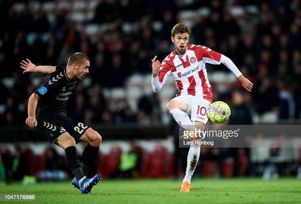 Josip Radosevic of Brondby IF and Lucas Andersen of AaB Aalborg compete for the ball during the Danish Superliga match between AaB Aalborg and...
