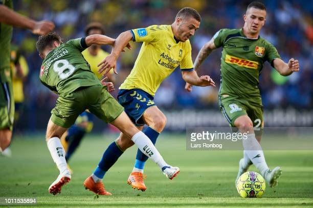 Josip Radosevic of Brondby IF Magnus Kofod Andersen of FC Nordsjalland and Karlo Bartolec of FC Nordsjalland compete for the ball during the Danish...