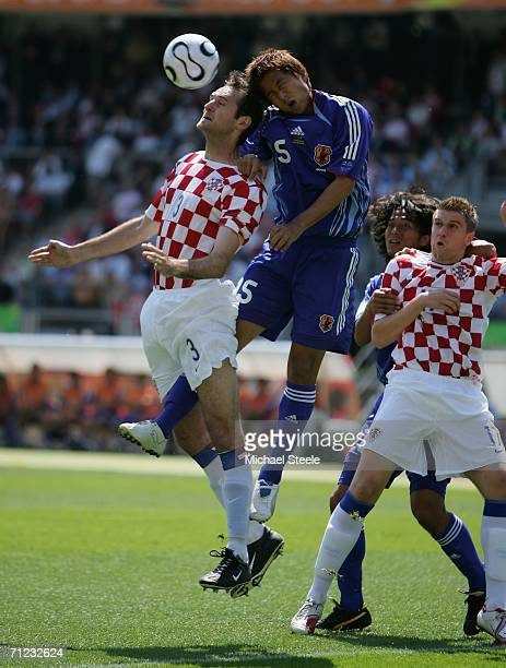 Josip Simunic of Croatia fights for the ball with Takashi Fukunishi of Japan during the FIFA World Cup Germany 2006 Group F match between Japan and...