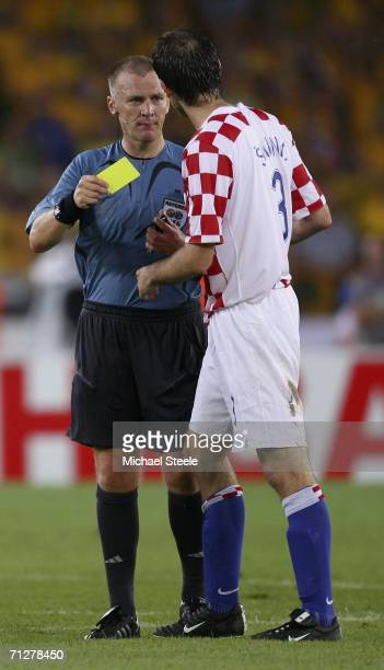 Josip Simunic of Croatia is shown a yellow card by English referee Graham Poll during the FIFA World Cup Germany 2006 Group F match between Croatia...
