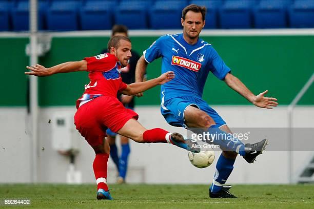 Josip Simunic of Hoffenheim blocks a shot of Soldado of Getafe during the pre season friendly match between 1899 Hoffenheim and FC Getafe at the...