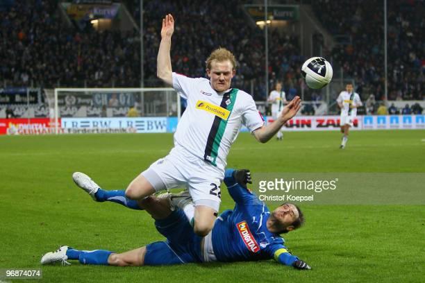 Josip Simunic of Hoffenheim fouls Tobias Levels of Gladbach during the Bundesliga match between 1899 Hoffenheim and Borussia Moenchengladbach at...
